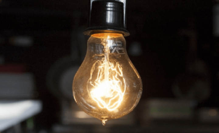 Uncovered lightbulbs may expose food to which type of hazard?